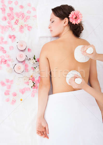 Woman Getting Herbal Compress Ball Therapy Stock photo © AndreyPopov