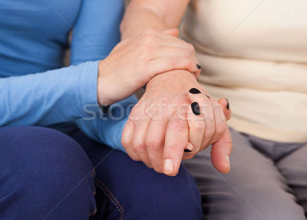 Female Caregiver Consoling Senior Woman Stock photo © AndreyPopov