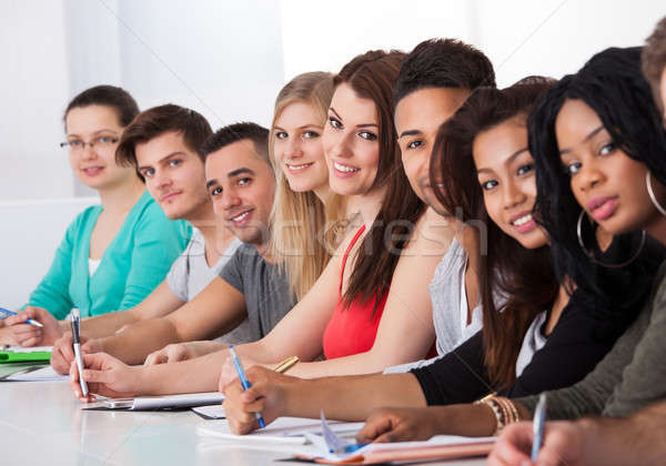 Stock photo: College Students Sitting In A Row At Desk
