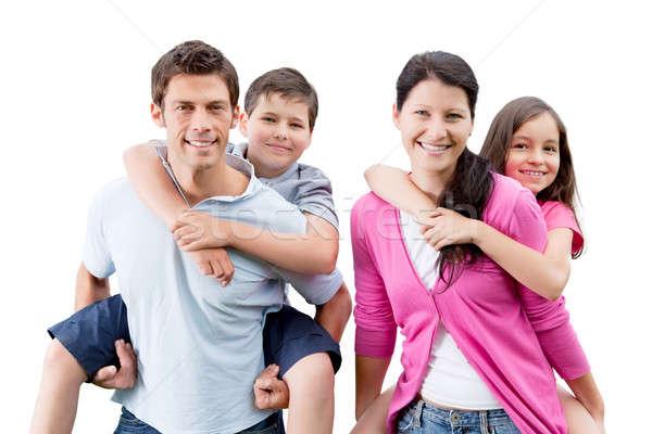 Happy Parents Piggybacking Children Stock photo © AndreyPopov