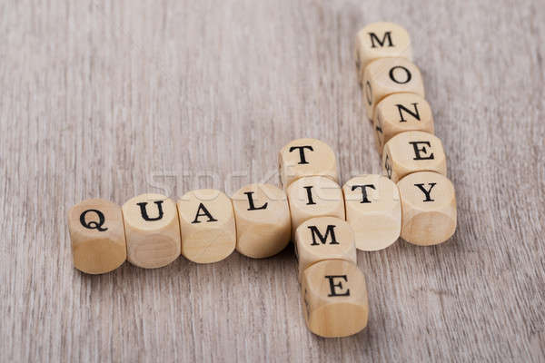 Quality; Time And Money Cubes Arranged On Table Stock photo © AndreyPopov