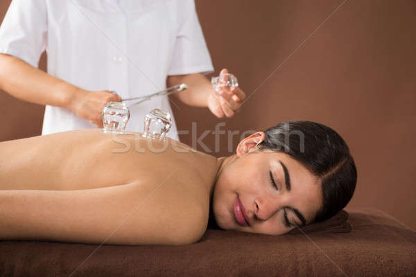 Young Woman Getting Cupping Treatment Stock photo © AndreyPopov