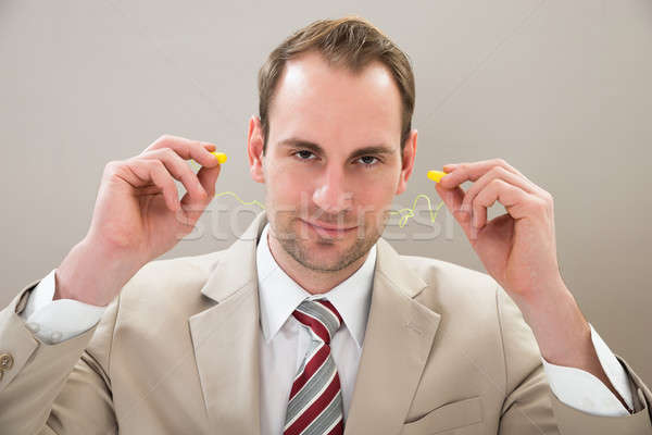Businessman With Earplug Stock photo © AndreyPopov