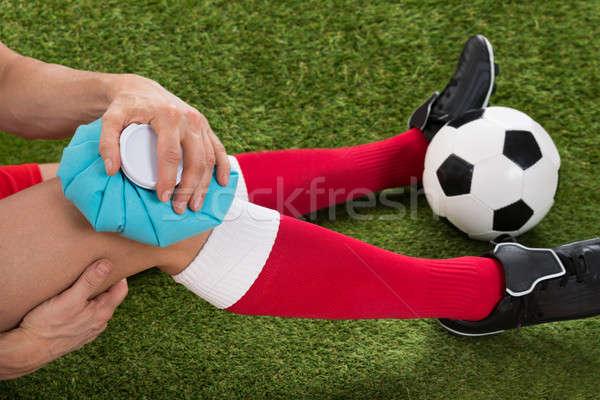 Futbolcu buzlanma diz buz paketlemek Stok fotoğraf © AndreyPopov