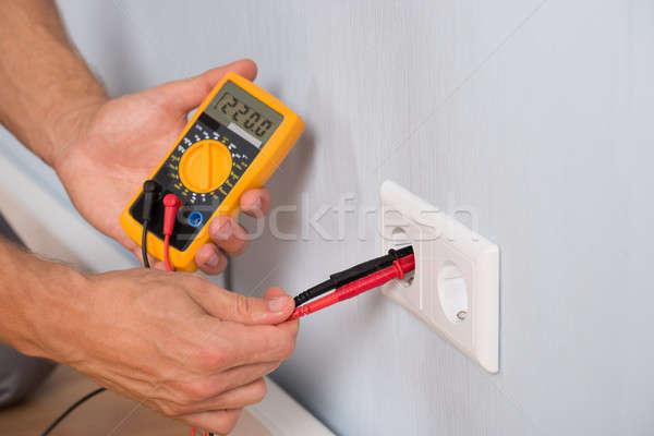 Person Hand Metering Socket Voltage Stock photo © AndreyPopov