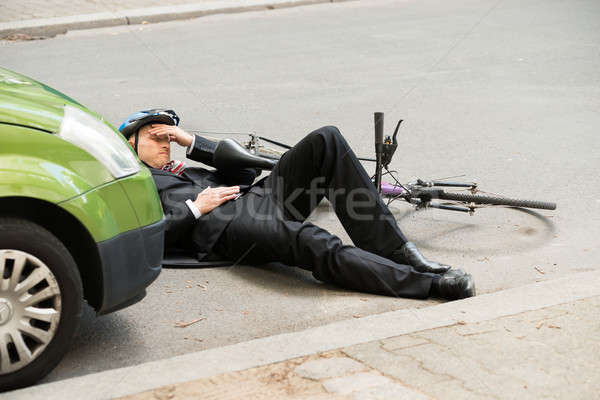Male Cyclist After Car Accident On Road Stock photo © AndreyPopov