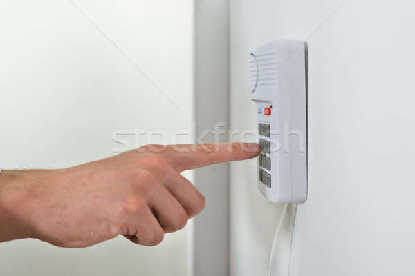 Person Hand Pressing Button On Security System Stock photo © AndreyPopov
