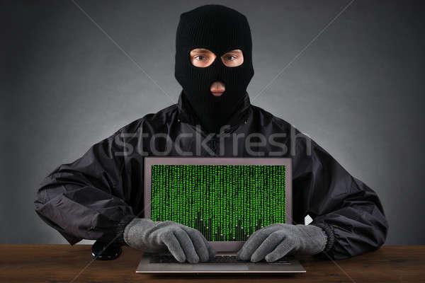 Hacker gépel laptop bináris kód fekete maszk Stock fotó © AndreyPopov
