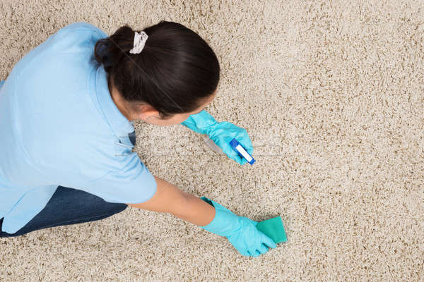 Young Woman Cleaning Carpet Stock photo © AndreyPopov