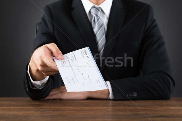 Homme d'affaires chèque bois bureau affaires Photo stock © AndreyPopov
