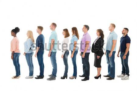 Side View Of Creative Business People Standing In Row Stock photo © AndreyPopov