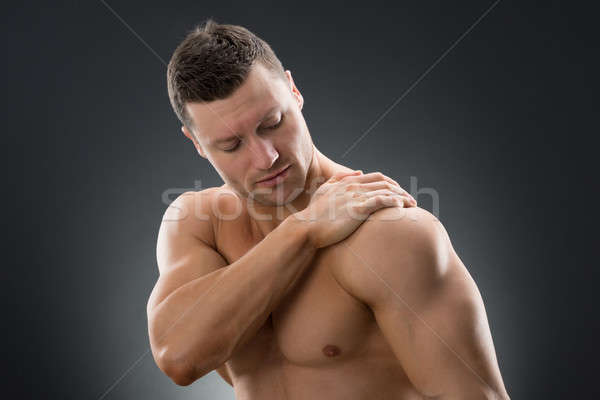 Muscular Man Suffering From Shoulder Pain Stock photo © AndreyPopov