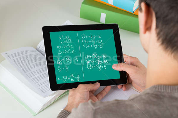 Student Learning Mathematical Equations On Digital Tablet Stock photo © AndreyPopov