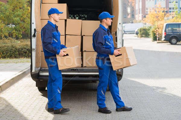 Livraison hommes carton cases souriant Photo stock © AndreyPopov