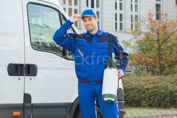 Confident Pest Control Worker Wearing Cap Stock photo © AndreyPopov