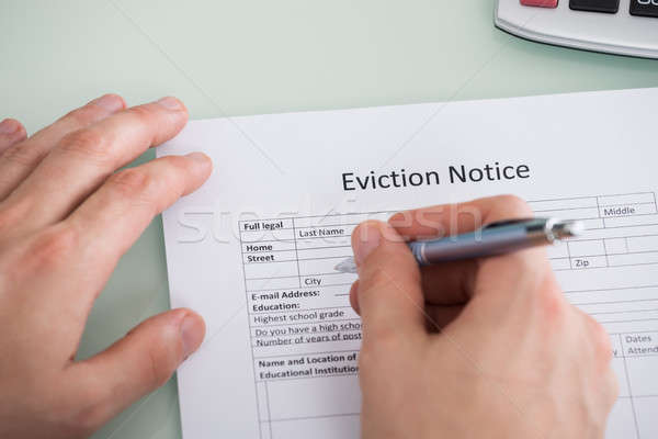 Person Hand Filling Eviction Notice Form Stock photo © AndreyPopov