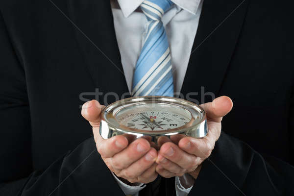 Person Hand Holding Compass Stock photo © AndreyPopov