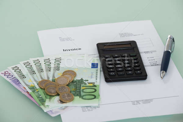 Invoice And Currency On Desk Stock photo © AndreyPopov