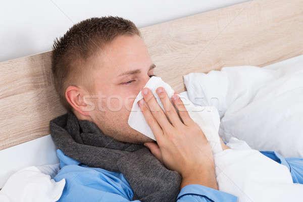 Uomo freddo soffia il naso ritratto giovane naso Foto d'archivio © AndreyPopov