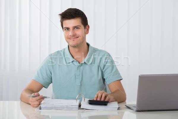 Man Calculating Tax Stock photo © AndreyPopov