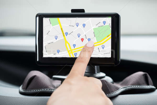 Female's Hand Using GPS Navigation  Stock photo © AndreyPopov