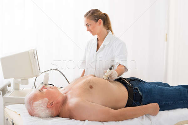 Doctor Using Ultrasound Scan On Abdomen Of Male Patient Stock photo © AndreyPopov