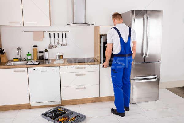 Technicus oven keuken jonge mannelijke Stockfoto © AndreyPopov