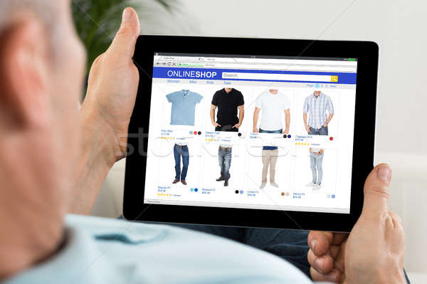 Close-up Of Person Shopping Online On Digital Tablet Stock photo © AndreyPopov