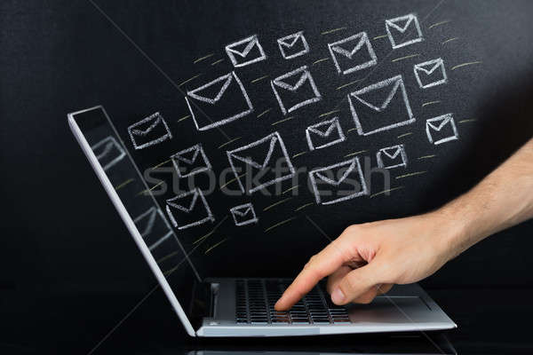Person Hand Sending The Email From Laptop Stock photo © AndreyPopov