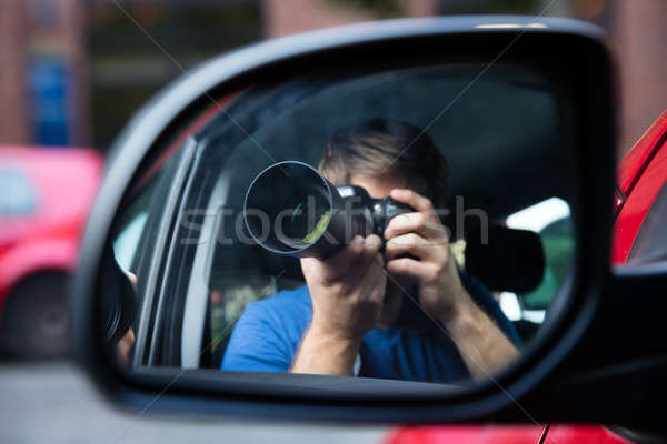 Man Sitting In Car Photographing Stock photo © AndreyPopov
