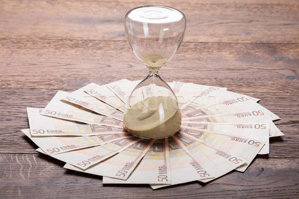 An Hourglass On Euro Notes Stock photo © AndreyPopov