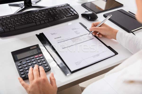 Businesswoman Calculating Invoice Stock photo © AndreyPopov