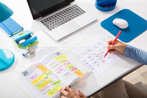 Businesswoman Marking Schedule On Calendar Stock photo © AndreyPopov