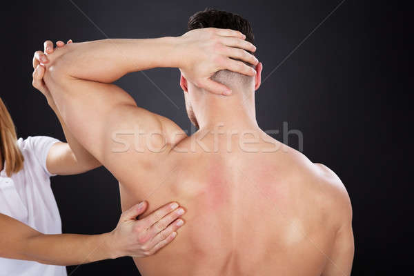 Physiotherapist Giving Shoulder Massage Stock photo © AndreyPopov