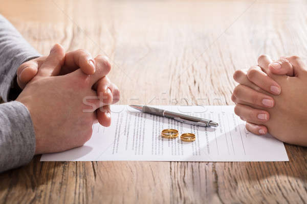 Couple's Hand On Divorce Agreement Stock photo © AndreyPopov