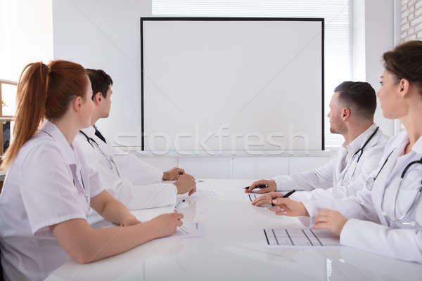 Doctors Looking At White Board Stock photo © AndreyPopov