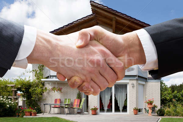 Realtor Shaking Hands With Client After Selling House Stock photo © AndreyPopov