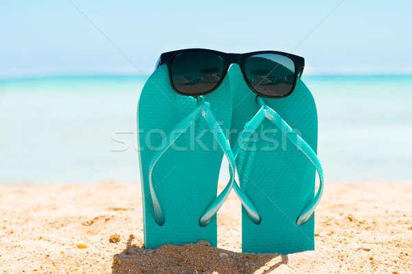 Gafas de sol turquesa arena playa verano cielo Foto stock © AndreyPopov
