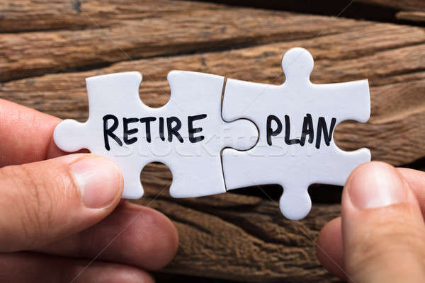 Hands Holding Retire Plan Matching Jigsaw Pieces Stock photo © AndreyPopov