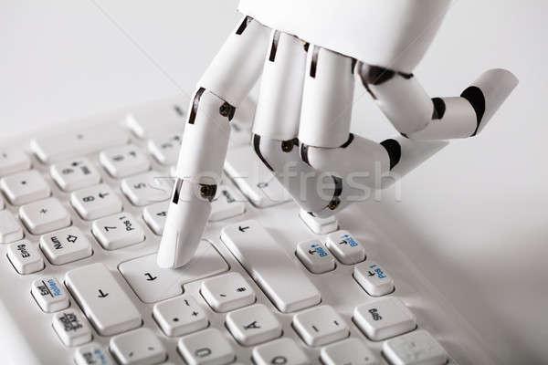 Robotikus kéz kisajtolás belépés kulcs közelkép Stock fotó © AndreyPopov