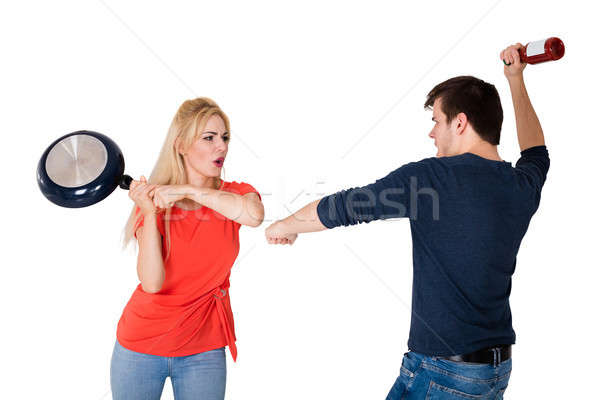 Couple Fighting Against White Background Stock photo © AndreyPopov