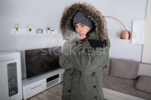 Man With Warm Clothing Feeling The Cold Stock photo © AndreyPopov
