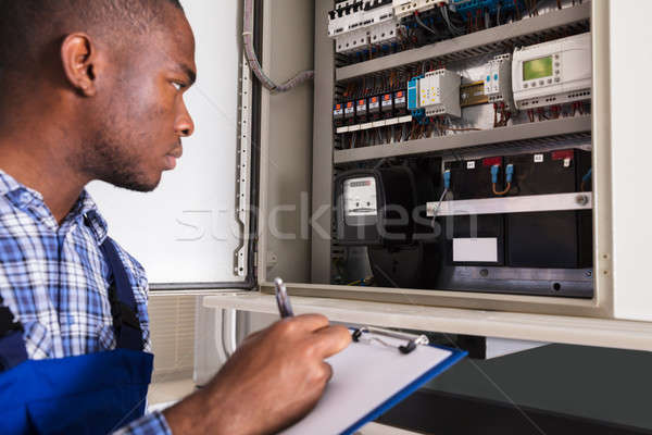 Male Technician Writing On Clipboard Stock photo © AndreyPopov
