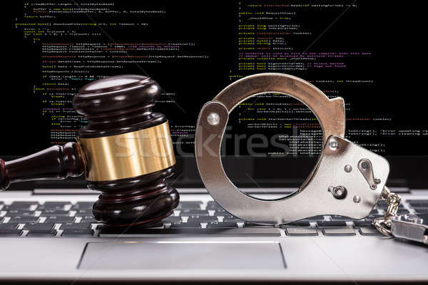 Handcuffs And Gavel In Front Of Laptop Screen Stock photo © AndreyPopov