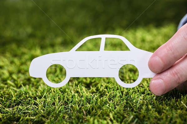 Person Holding Paper Car On Grass Stock photo © AndreyPopov