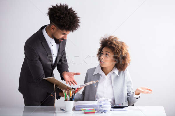 Businessman Showing Mistake To His Female Colleague Stock photo © AndreyPopov