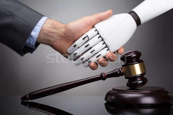 Gabela cinza empresário robô aperto de mãos Foto stock © AndreyPopov