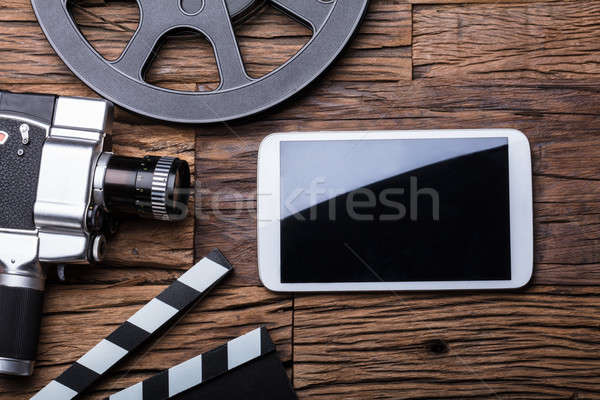 Elevated View Of Smartphone With Movie Camera And Film Reel Stock photo © AndreyPopov
