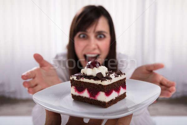 Woman Taking Slice Of Cake Stock photo © AndreyPopov