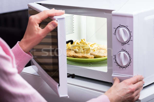 Woman Heating Food In Microwave Stock photo © AndreyPopov